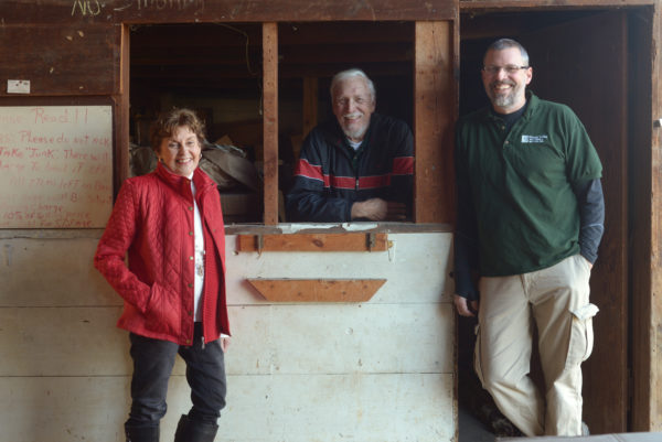 Greg Evans, owner of Green Valley Auctions, with his parents - the founders