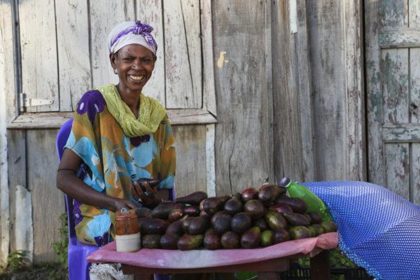 Ethiopian woman eating fresh fruits/vegetables in Ethiopia