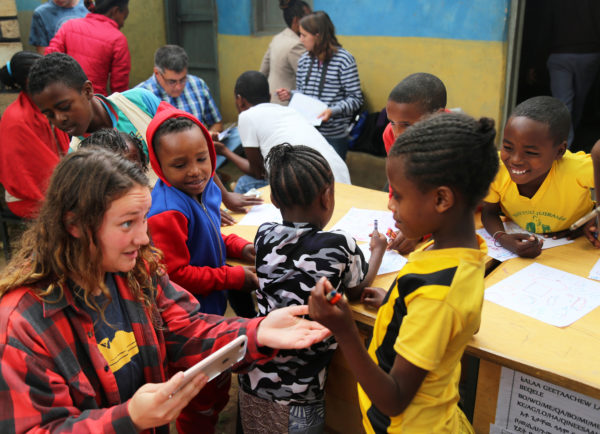 Volunteer with children in Ethiopia