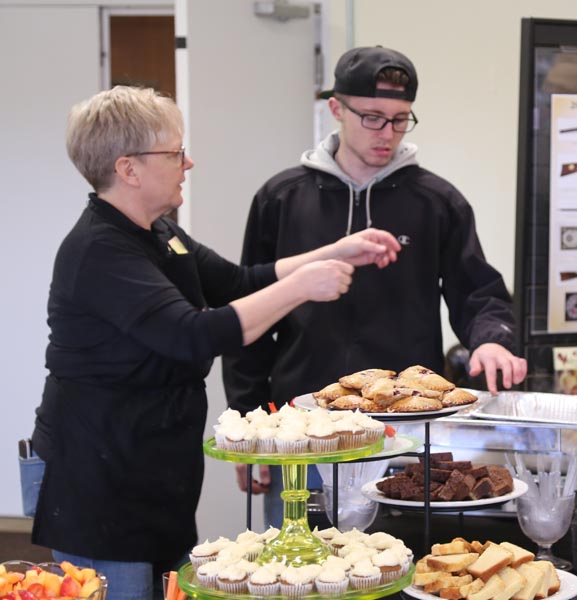 Elizabeth Evans & Scotty Evans serving food at Green Valley's Open House