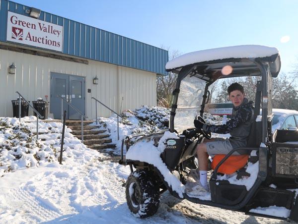 Ryan Evans driving the ATV