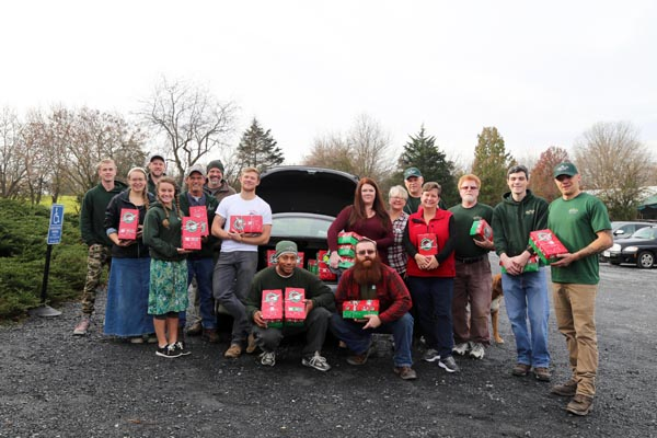 Green Valley employees pose with Operation Christmas Child boxes