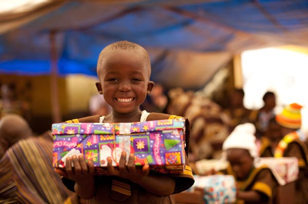 Photo of boy holding a box received from Operation Christmas Child