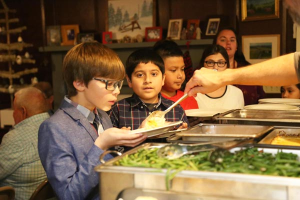 Second Home children being served dinner