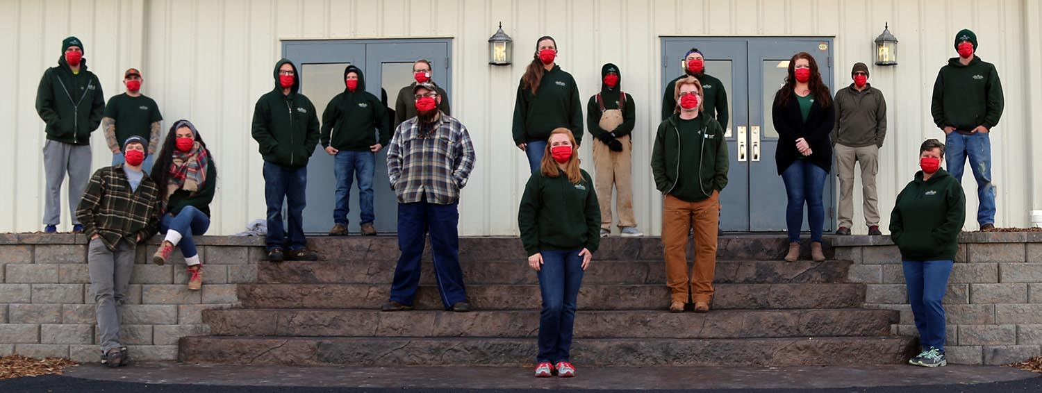 Green Valley Employees posing in front of building for Christmas Photo